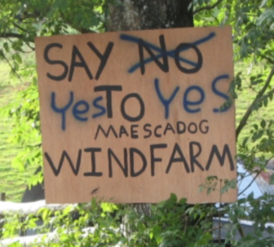 Conflict: poster objecting to the proposed wind turbine above Caio has been defaced.